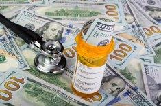 ACA stock-photo-46899302-prescription-bottle-and-hundred-dollar-bills